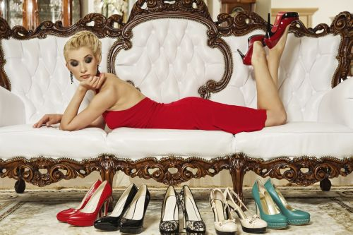 Beautiful glamorous woman looking at shoes